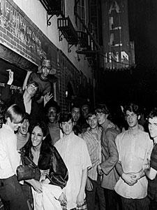 MIXED CROWD OUTSIDE THE STONEWALL INN