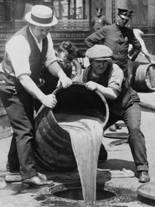 NEW YORK CITY DEPUTY POLICE COMMISSIONER JOHN A. LEACH (RIGHT) WATCHING AGENTS POUR LIQUOR INTO SEWER