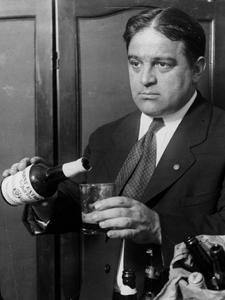 FIORELLO LA GUARDIA POURING BEER AT HIS CONGRESSIONAL OFFICE
